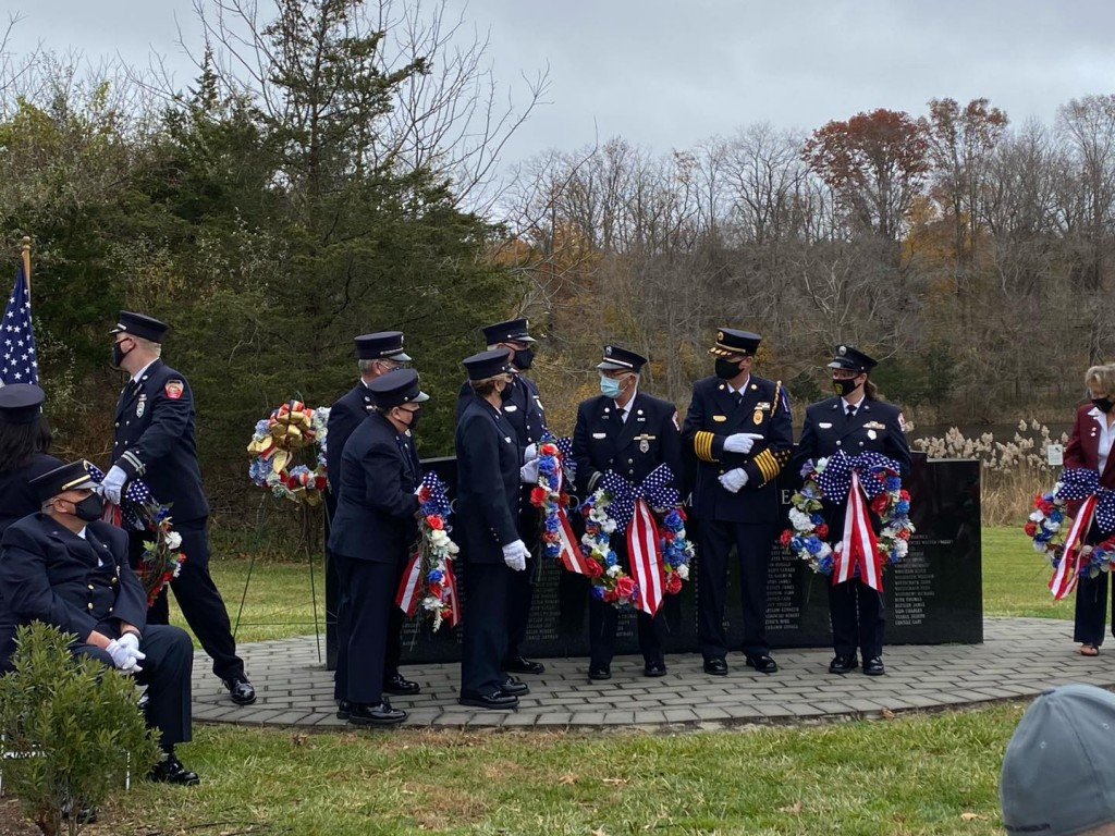 Firefighters with wreaths